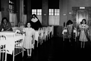 Nuns with young girls in dorm